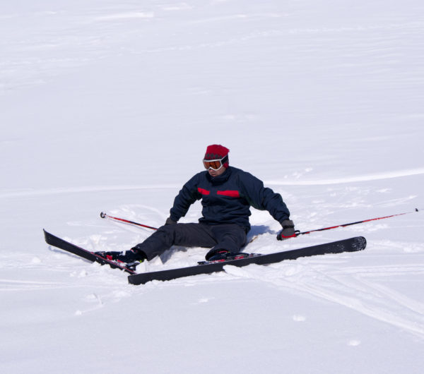 Young man is learning to ski in Palandoken, turkish ski resort.